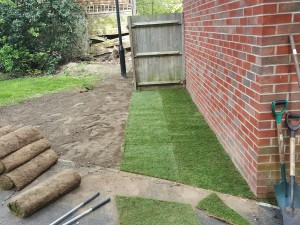 Grass repairs with laying new turf